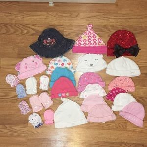 Bundle of baby girl hats and mittens
